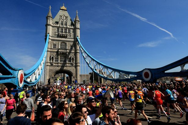 Spectators-watch-as-runners-cross-Tower-Bridge-during-the-Virgin-London-Marathon-in-London
