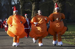 LONDON, DEC 3:-Participants dressed as turkeys take part in a Santa Run at Battersea Park in London, Britain December 3, 2016. REUTERS-28R